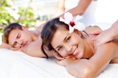 Beautiful young couple receiving massages at a spa